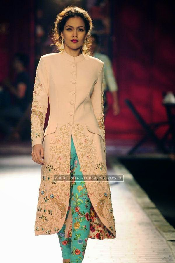 A model walks the ramp for Monisha Jaisingh on Day 3 of India Couture Week, 2014, held at Taj Palace hotel, New Delhi.