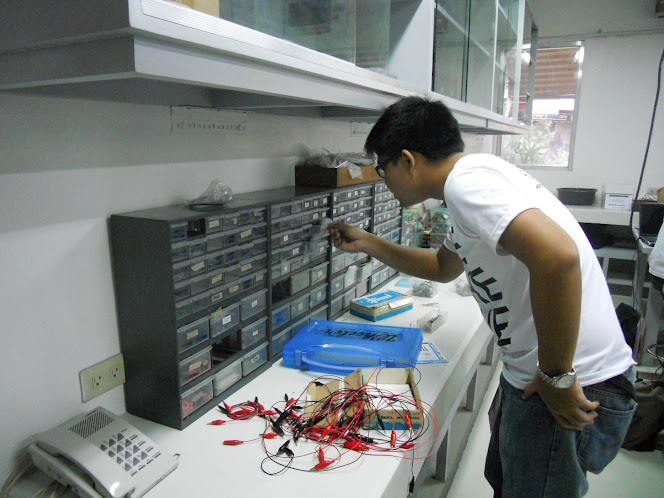 A student checks out the cabinet for spare resistors, diodes, and transistors