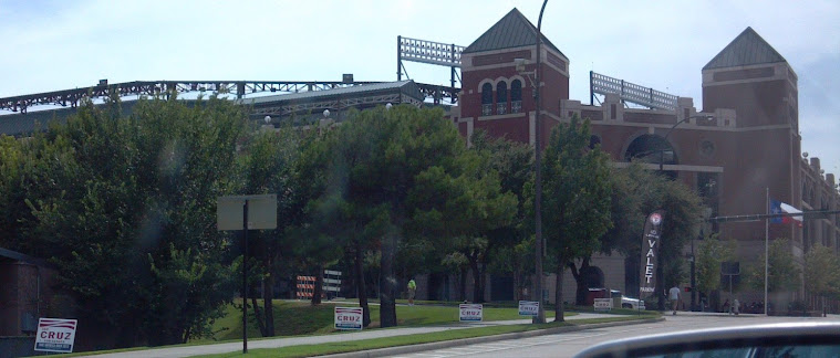 Ted Cruz for US Senate signs line the public right of way near Rangers Ballpark