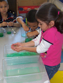 Children exploring the properties of water.