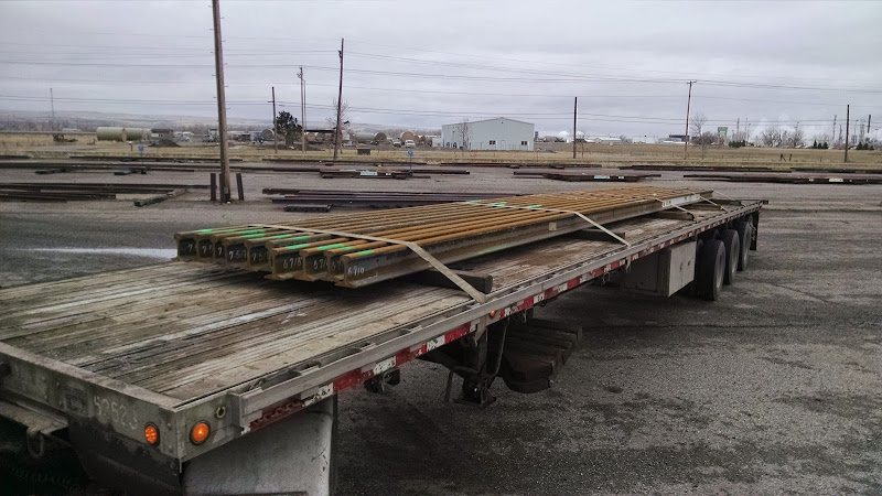 scrap steel beams loaded on a flatbed