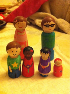 Colored wooden peg dolls