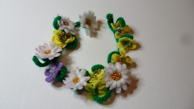 Crochet and felt Daisy chain with buttercups.