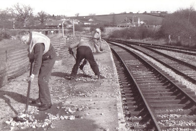 'Spot the bum'. Jim Kelly, Mike Thompson, Alan Tyrie - Remove the ballast after relaying the platform 1 road at Littlehempson Feb 1993.  Photo:  ?