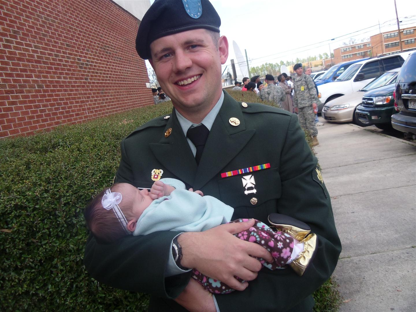 wife hat mom hat the best part of being an army wife it was derek s turn to be proud he was super eager to hold his baby girl i totally love this pic