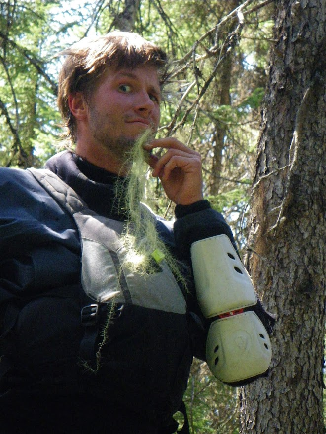 Chris Schwer plucking the happiness out of a tree--literally--during a grueling two hour portage.