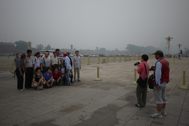 group having their photograph taken at Tiananmen Square