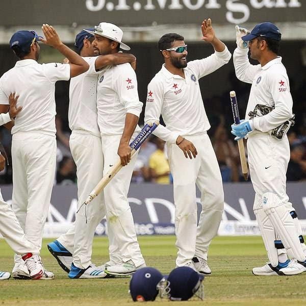 India's cricketers celebrate after winning by 95 runs on the fifth day of the second cricket Test match between England and India at Lord's cricket ground in London on July 21, 2014.