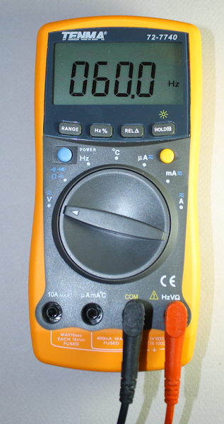 Tenma 72-7740 digital multimeter measuring 60Hz line frequency