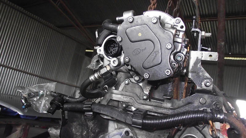 559189 460 Alternator Install besides 235383 Touareg R5 Tandem Pump Removal Install besides 282098 Temperature Sensor Location further Water Outlet To Heater Core On 87 5 0 further How To Check Transmission Fluid In 2012 Chevy Cruze. on water pump location on 4 0 ford