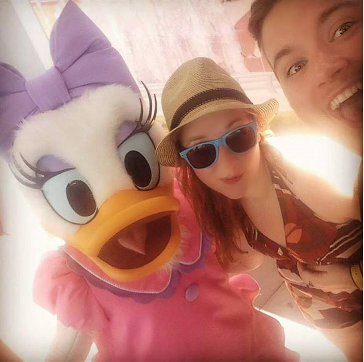 Emily and I posing with Daisy in Disney World