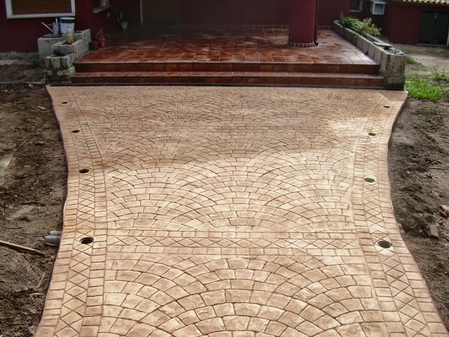 pavimento de hormign impreso molde de adoquin circular y cenefa pigmentada