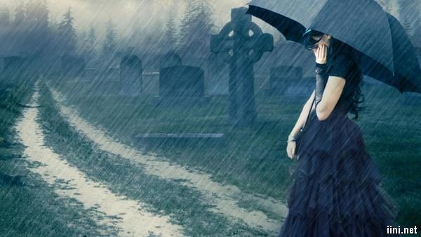 ảnh cô gái thăm mộ người yêu trong mưa