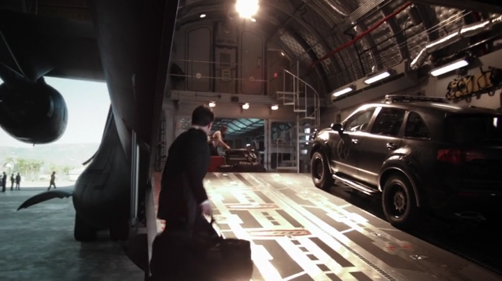 Screencap from first episode of Agents of SHIELD showing the ramp entrance to the black airplane flying headquarters