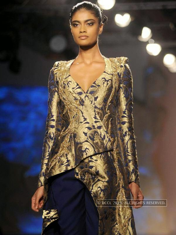 walks the ramp for designer Gaurab Gupta on Day 3 of India Couture Week, 2014, held at Taj Palace hotel, New Delhi.<br />