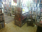 formidable array of old tomes in floor to cieling bookcases