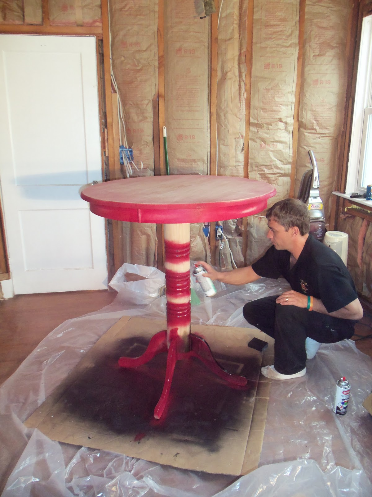 Distressed shabby chic black red pub table first my husband gordon and i painted the areas around the table that i wanted the burgundy color to show through watchthetrailerfo