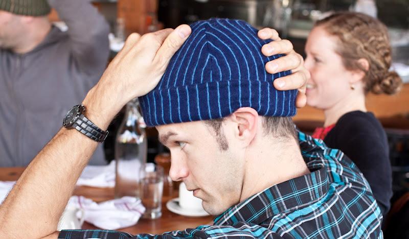 Navy Cashmere Beanie hat held on head