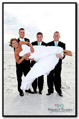 Groom and Groomsmen holding the Bride