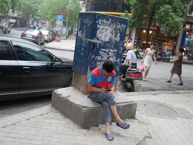 man looking at his mobile phone in Hengyang, Hunan, China