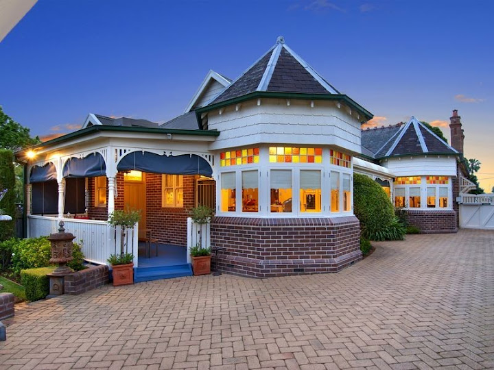 Queen Anne style with tuckpointed brickwork and timber verandah balustrades