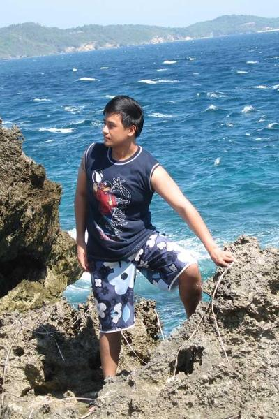 PauTravels at rocky cliffs at the crystal caves in Boracay