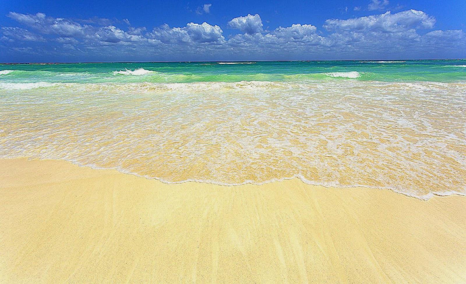 surf on white sandy beach  Mayan Riviera