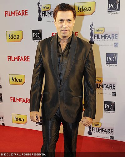 Madhur Bhandarkar strikes a pose at the 58th Idea Filmfare Awards in Mumbai.Click here for:<br />  58th Idea Filmfare Awards