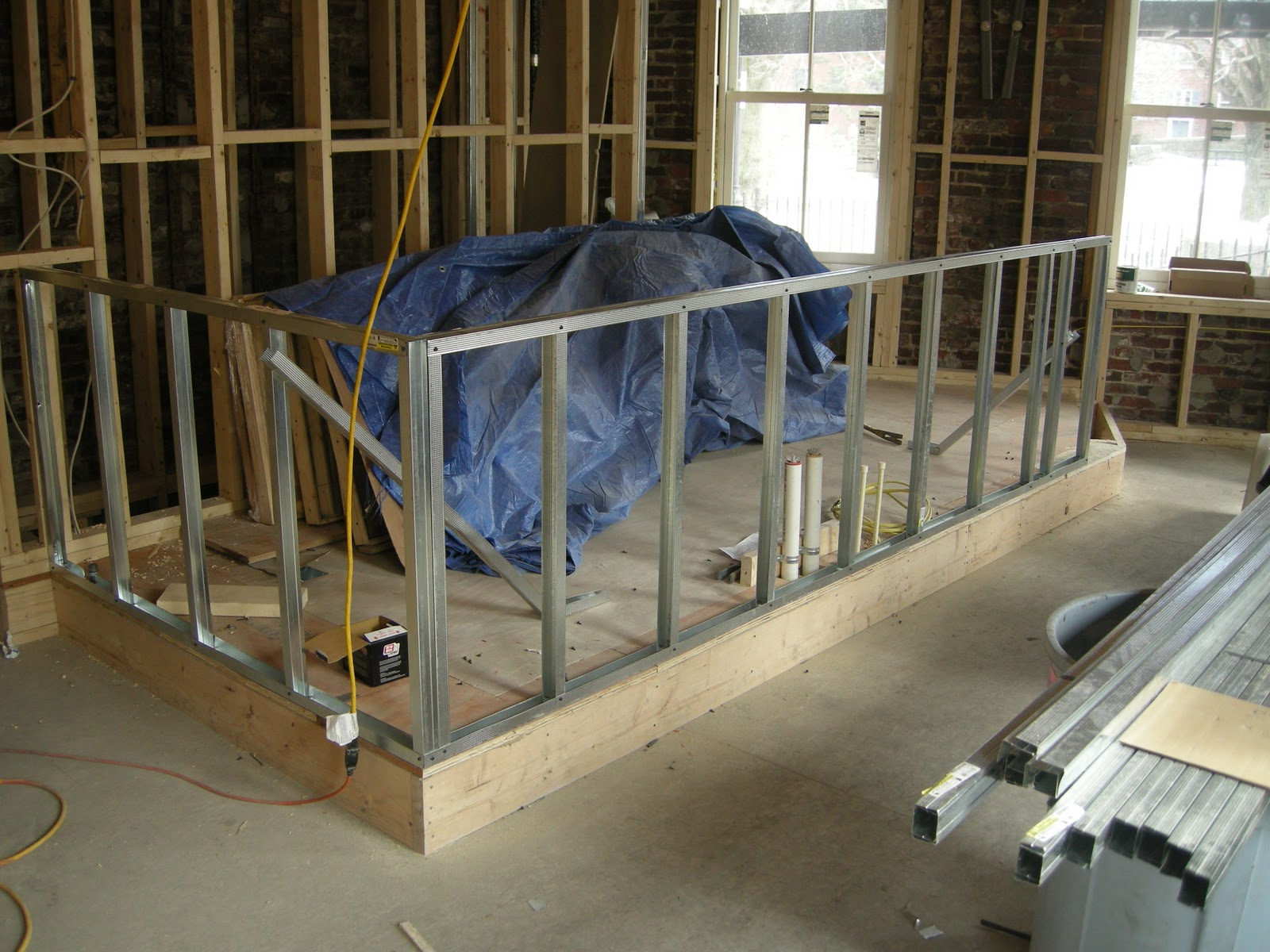 redbrickbuilding: The heat is on! Plus, Unit 2 kitchen cabinet framing