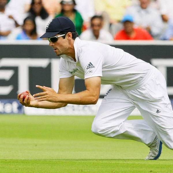 England's captain Alastair Cook catches out India's Stuart Binny for zero during the fourth day of the second test match between England and India at Lord's cricket ground in London, Sunday, July 20, 2014.