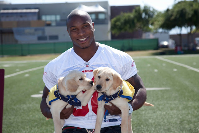 Parys Haralson and two puppies