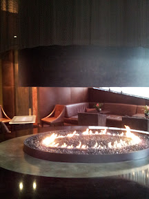 Fireplace and to the back left the Surface in Studio 1000 lounge at Hotel 1000