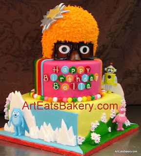 Three tier Yo Gabba Gabba custom designed birthday cake with DJ Lance top tier, Muno, Foofa, Brobee, Toodee and Plex toys