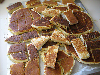 A photo of cut up pancakes on a cutting board.