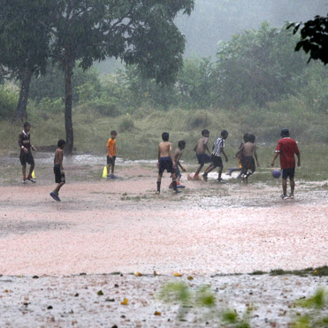 Kids playing soccer in Goa, India