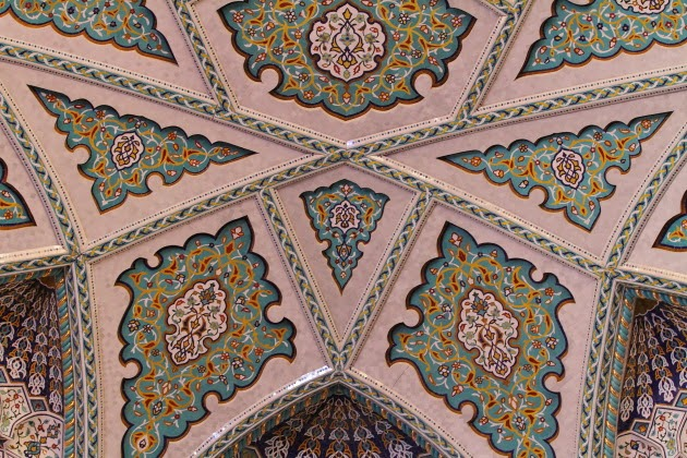 Coloured patters on the inside walls of Sultan Qaboos Grand Mosque dome