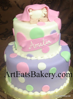 Baby bottom under blanket pink, purple, white and green fondant polka dot modern creative baby shower cake design