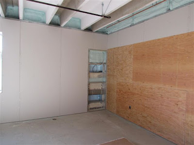 Sheetrock/plywood wall installed in classroom
