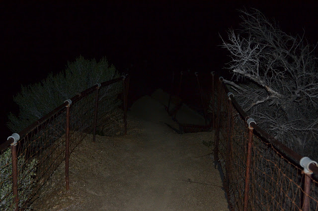 trail dropping into the dark