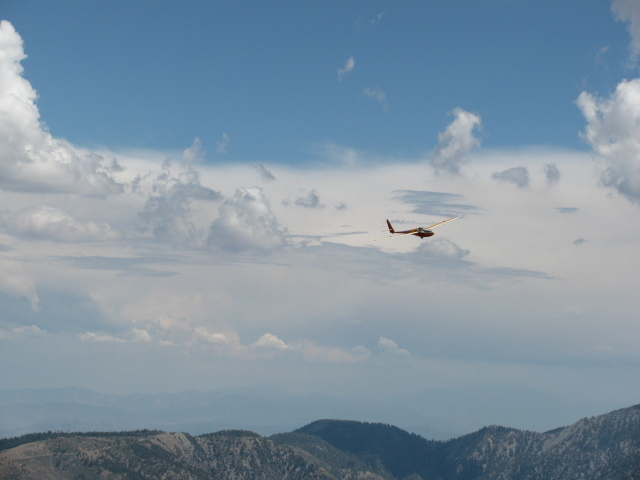 red glider over the mountains