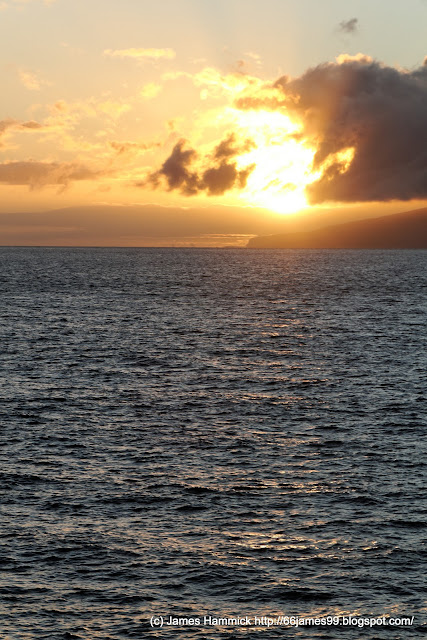 Sunset from Maui over sea cliffs of Lanai