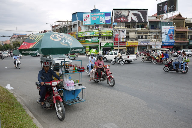 man riding motorbike with mobile drink cart