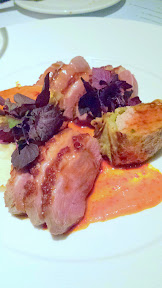 Bluehour entree of Smoked Duck Breast with sweet potato, savoy cabbage, and ginger sausage