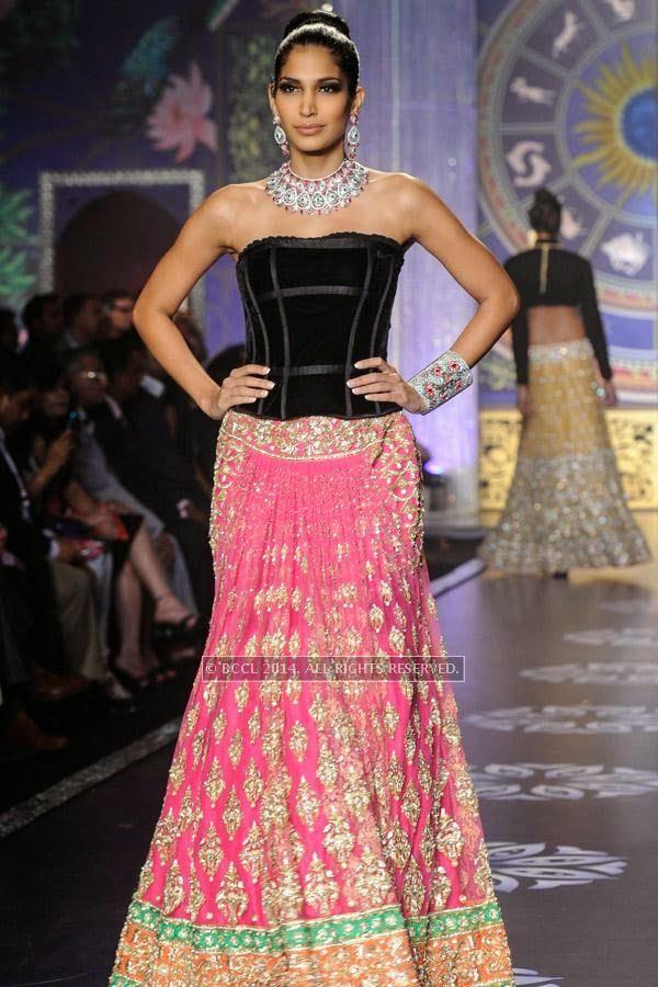 A model walks the ramp for the finale of India International Jewellery Week (IIJW), 2014, held at Grand Hyatt, in Mumbai.