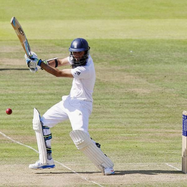England's Moeen Ali (L) plays a shot during the second day of the second Test cricket match between England and India, at Lord's Cricket Ground in London, England on July 18, 2014.