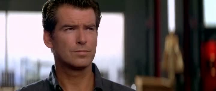 Screen Shot Of Hollywood Movie Tomorrow Never Dies (1997) In Hindi English Full Movie Free Download And Watch Online at alldownloads4u.com