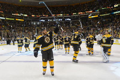 Bruins players salute the fans after they beat the NY Rangers and win the series