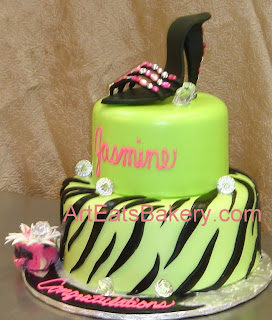 Two tier green, pink and black zebra custom cake with sugar shoe, shopping bag and faux diamonds