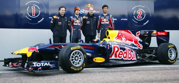 (L-R) Red Bull Formula One Team Principal Christian Horner, driver Sebastian Vettel of Germany, Chief Technical Officer Adrian Newey and driver Mark Webber of Australia stand next to the RB7 after its unveiling at the presentation of the 2011 Red Bull Formula One team at the Ricardo Tormo racetrack in Cheste, near Valencia, February 1, 2011.  REUTERS/Heino Kalis (SPAIN - Tags: SPORT MOTOR RACING)