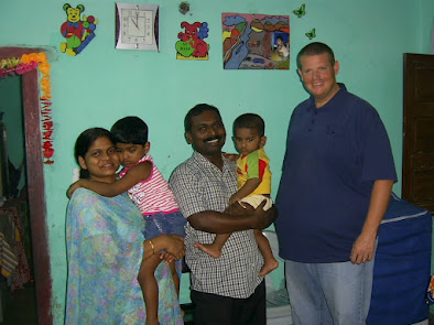 Pastor Santhosh and his family in their home